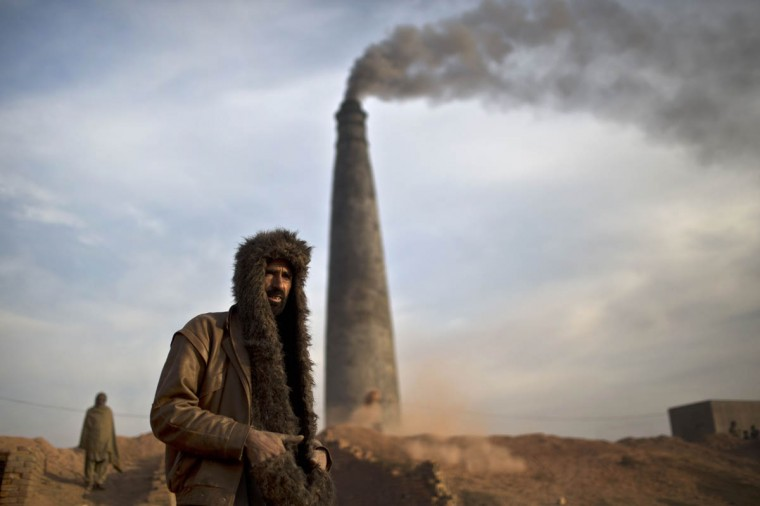 Pakistani brick factory worker Ghulam Mohammed, 41, arrives to work in a brick factory in Mandra near Rawalpindi, Pakistan, Wednesday, Dec. 31, 2014. (Muhammed Muheisen/AP photo)