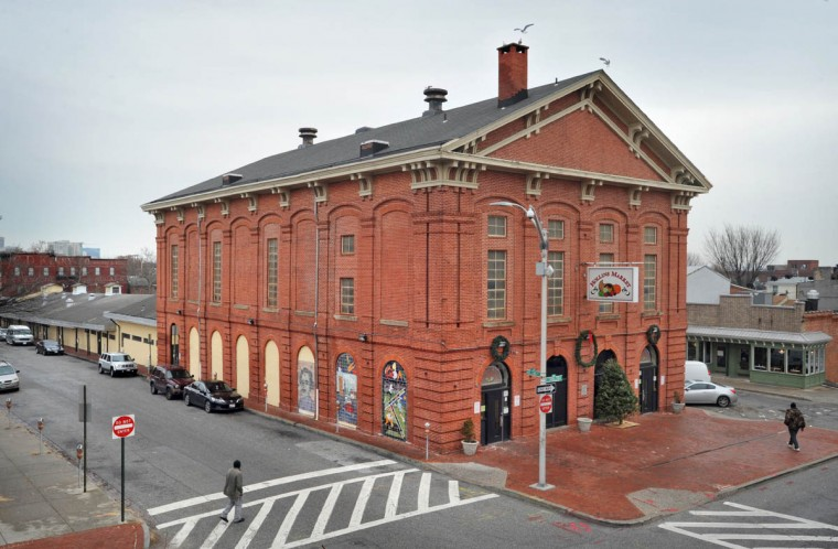 The tall brick structure west of the long shed at Hollins Market dates back to 1877. It's the oldest of the existing neighborhood markets, and was established in 1846. (Amy Davis, Baltimore Sun)
