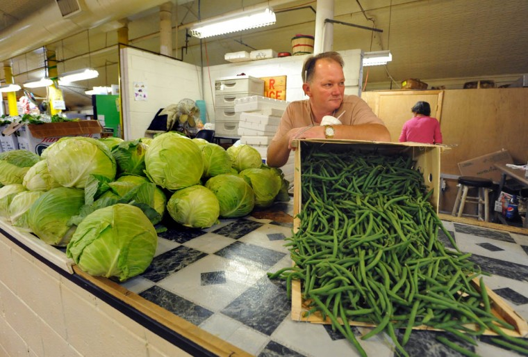 "Francis Joseph Baroch, 51, whose nickname is ""Lumpy,"" is the owner of L&R Produce. He has worked at Hollins Market for 27 years. His grandfather, Edwin Tharle sold produce from a truck at Monroe and Lombard Streets. At one time there were three produce stands at Hollins Market: Lumpy's, his parents' and another vendor. Now L&R is the only one. (Amy Davis, Baltimore Sun)"
