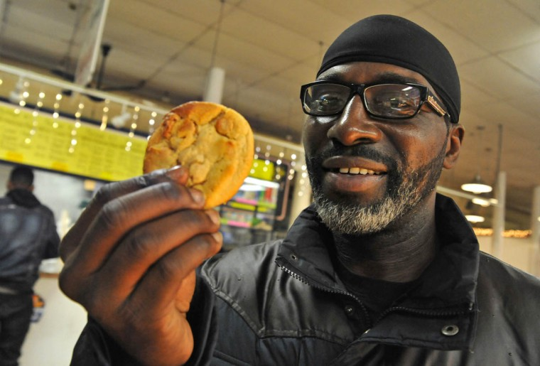 Tony Johnson comes from Woodlawn twice a week for the peanut butter cookies at MTD bakery at Hollins Market. (Amy Davis, Baltimore Sun)
