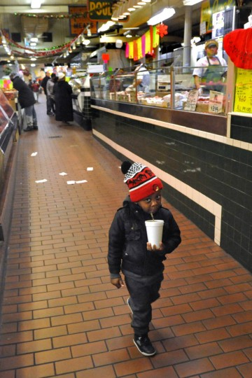 Jayden Jones, 3, sips a drink while visiting the Hollins Market with his mother, Sierra Jones (not pictured). (Amy Davis, Baltimore Sun)