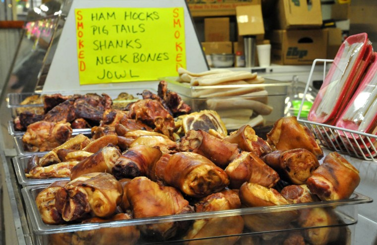 Detail of smoked ham hocks (foreground), pig tails, ham shanks and neck bones at Bernie's Meats in the Hollins Market. (Amy Davis, Baltimore Sun)