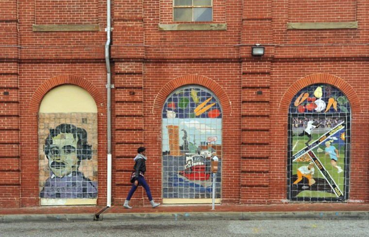 Tile murals on the north side of of Hollins Street at the Hollins Market. The Amity Street home of Edgar Allan Poe, pictured at left, is a half mile from the market. (Amy Davis, Baltimore Sun)