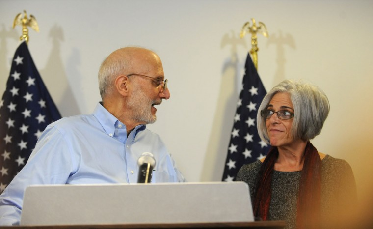 Alan Gross -with his wife, Judy, standing next to him- speaks to the press at Gilbert LLP law firm after being released from a Cuban prison. (Photo by Algerina Perna/Baltimore Sun)