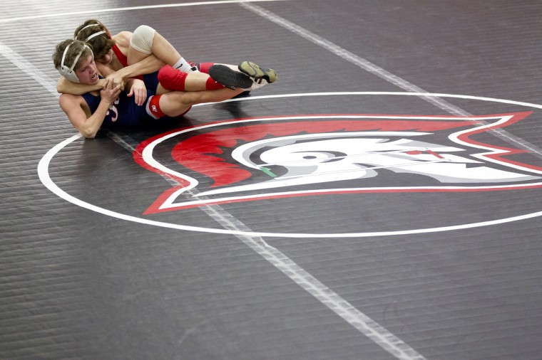 Reservoir's Reese Kilcarr, left, wrestles Glenelg's Logan Gwin, right, during the 106-pound wresting match at Glenelg High School in Glenelg, MD on Tuesday, December 9, 2014. (Jen Rynda/BSMG)