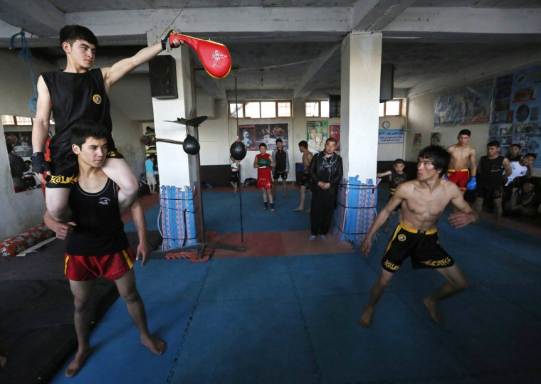 Abbas Alizada, who calls himself the Afghan Bruce Lee, works out during a media event in Kabul December 9, 2014. (Mohammad Ismail/Reuters)