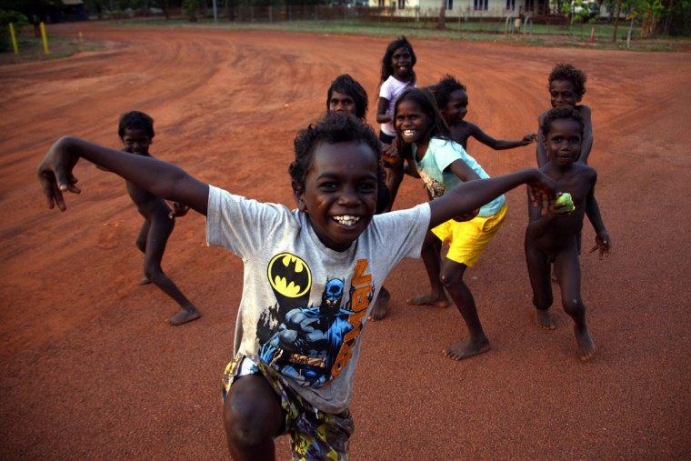 Australian Aboriginal children play on the dirt road that is the main street in the community of Ramingining in East Arnhem Land. (David Gray/Reuters)