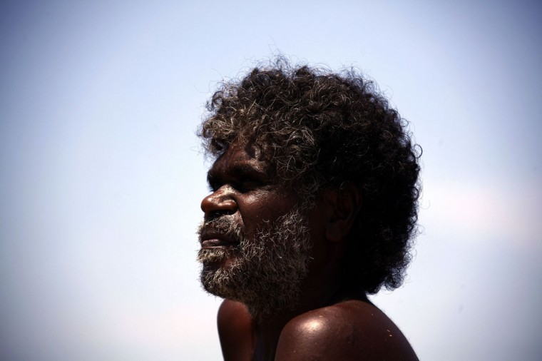 Australian Aboriginal hunter Bruce Gaykamangu of the Yolngu people looks across a billabong at potential prey near the 'out station' of Ngangalala, located on the outskirts of the community of Ramingining in East Arnhem Land. (David Gray/Reuters)
