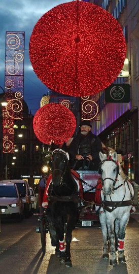 A traditional Fiaker horse carriage travels under Christmas lights in the inner city of Vienna December 18, 2014. Picture taken December 18. (Heinz-Peter Bader/Reuters)