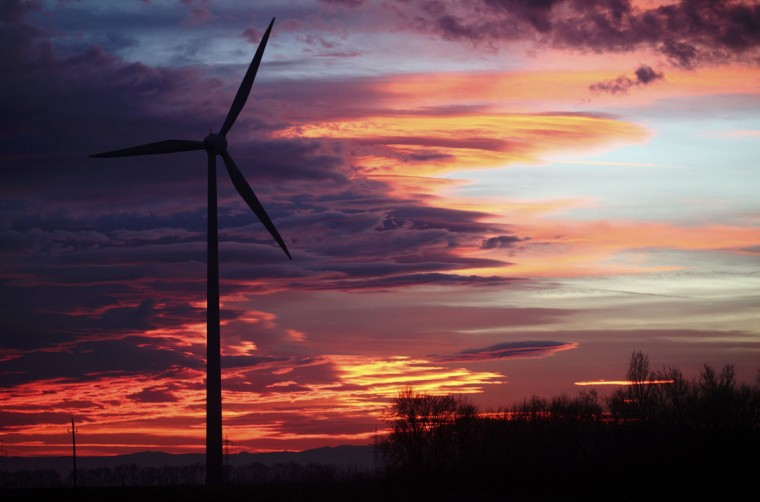 The setting sun illuminates the sky behind wind turbines of a wind park near Neusiedl am See. (Heinz-Peter Bader/Reuters)