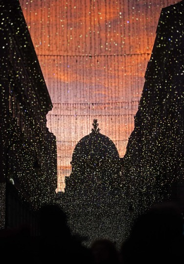 The setting sun fills the sky above Hofburg Palace's Michaeler Cupola and Christmas lights in Vienna December 12, 2014. (Heinz-Peter Bader/Reuters)