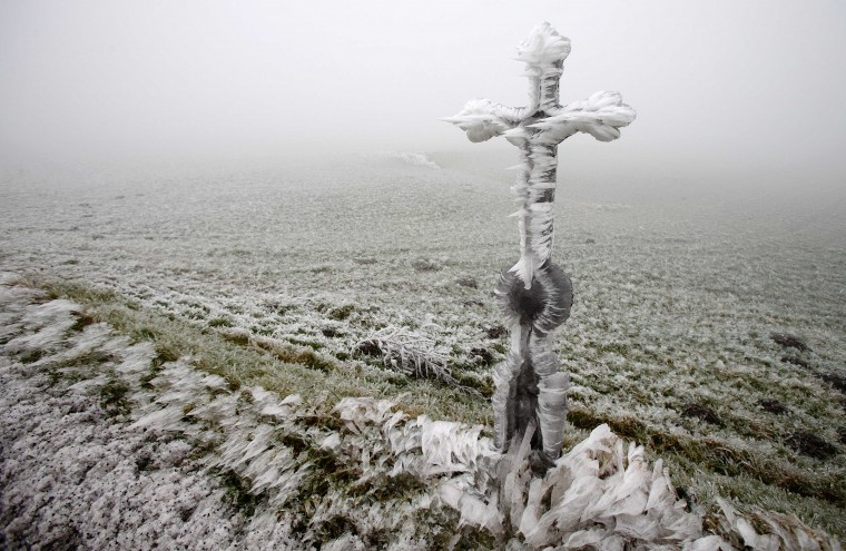 A roadside shrine is covered with ice Himberg in northern Austria, December 3, 2014. Freezing fog and rain has covered parts of the region with ice, causing blocked roads due to fallen trees and closed schools for security reasons, local media report. (Heinz-Peter Bader/Reuters)