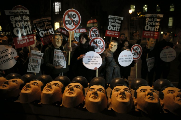 Campaigners dressed as Britain's Chancellor of the Exchequer George Osborne protest opposite Downing Street in central London December 2, 2014. (REUTERS/Stefan Wermuth)