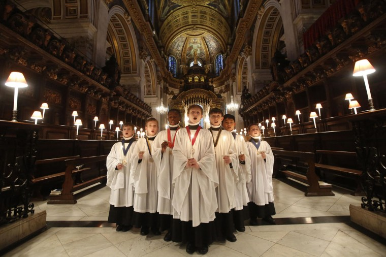 Choristers of St Paul's Cathedral sing Christmas carols during a photocall inside the Cathedral in central London December 22, 2014. Christmas is one of the busiest times of year for the choir who will sing to over 20,000 people over the Christmas period. (Luke MacGregor/Reuters)