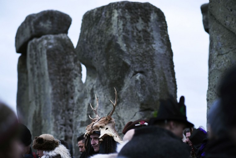 Revelers celebrate as the sun rises during the winter solstice at Stonehenge on Salisbury plain in southern England December 22, 2014. The winter solstice is the shortest day of the year, and the longest night of the year. (Dylan Martinez/Reuters)