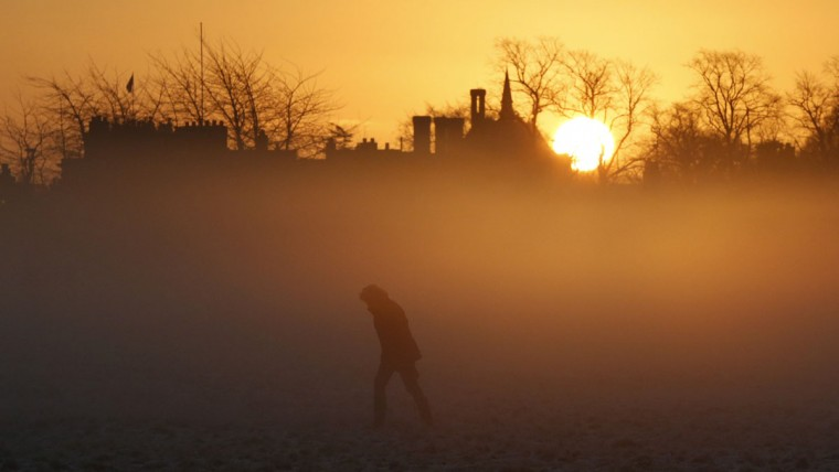 A person walks during sunrise in Knutsford, northern England, December 29, 2014. (Phil Noble/Reuters)