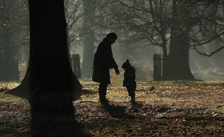 People walk in Dunham park near Altrincham, northern England December 29, 2014. (Phil Noble/Reuters)