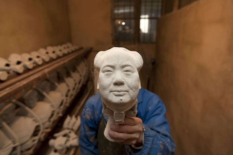A worker makes a bronze statue of China's late Chairman Mao Zedong at a factory in Shaoshan, Hunan province, December 7, 2014. Friday, December 26, 2014 will mark the 121st birth anniversary of Mao. Picture taken December 7, 2014. (Darwin Zhou/Reuters)