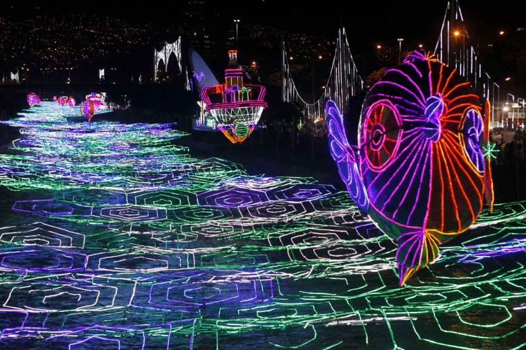 Christmas decorations light up the Medellin river in Medellin December 10, 2014. (Fredy Builes/Reuters)