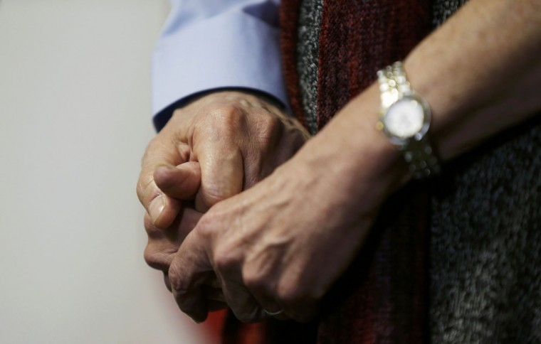 Alan Gross and his wife Judy hold hands during a news conference in Washington hours after Alan's release from Cuba on December 17, 2014. Cuba released Gross after five years in prison in a reported prisoner exchange. REUTERS/Gary Cameron