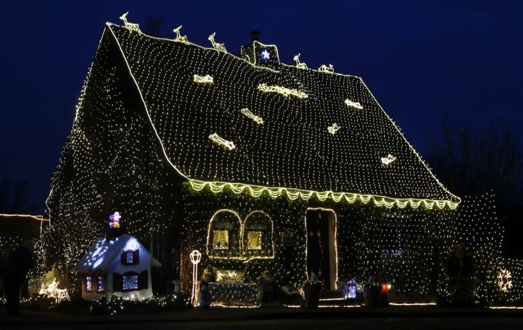 A house in the town of Stolberg near the western German city of Aachen is decorated for Christmas with some 200,000 LED lights December 16, 2014. Every year hundreds of houses across Germany are decorated by their owners with lights ahead of Christmas. (Wolfgang Rattay/Reuters)