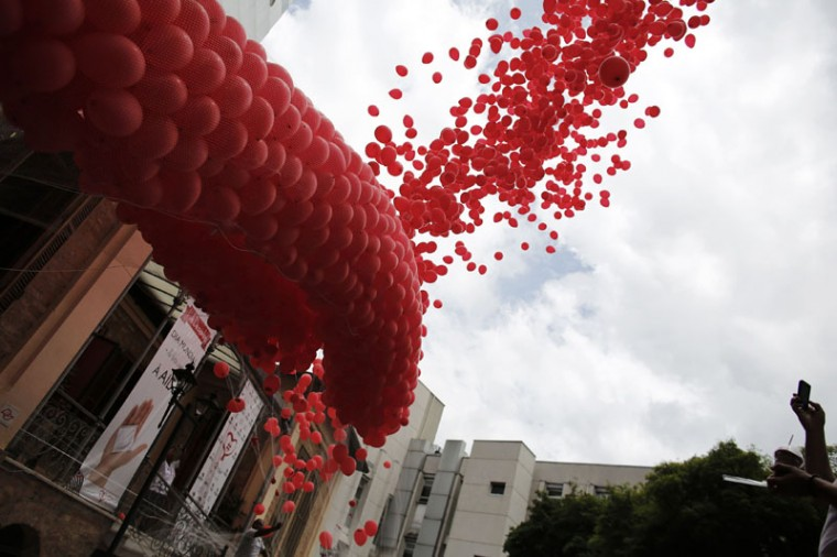 """Red balloons are released to mark World Aids Day at the Emilio Ribas Hospital in Sao Paulo December 1, 2014. The world has finally reached """"the beginning of the end"""" of the AIDS pandemic that has infected and killed millions in the past 30 years, according to a leading campaign group fighting HIV. United Nations data show that in 2013, 35 million people were living with HIV, 2.1 million people were newly infected with the virus and some 1.5 million people died of AIDS. By far the greatest part of the HIV/AIDS burden is in sub-Saharan Africa. (Nacho Doce/Reuters)"""