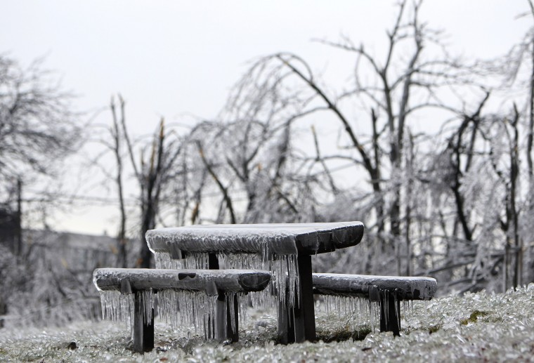Benches covered in ice in Buda hills in Budapest, December 3, 2014. Tens of thousand homes on the outskirts of Budapest went without electricity this week as freezing rain blanketed the area and falling trees cut power lines, Hungary's Disaster Relief Agency said. (Bernadett Szabo/Reuters)