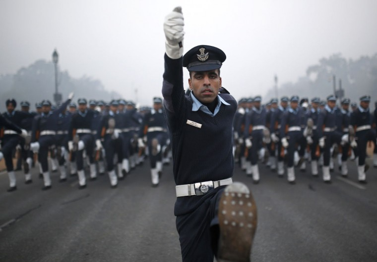 Indian Air Force soldiers rehearse for the Republic Day parade on a cold and foggy winter morning in New Delhi December 30, 2014. India will celebrate its annual Republic Day on January 26. (Ahmad Masood/Reuters)