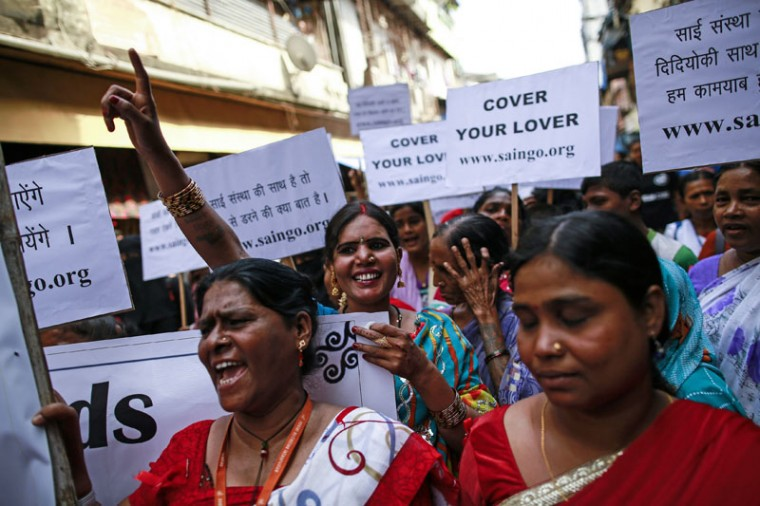 Sex workers mark World AIDS Day in Kamathipura, Mumbai's red light district, December 1, 2014. The event was organized by the Social Activities Integration, a non-profit organization which provides free condoms and medical care to people living with HIV and AIDS. (Danish Siddiqui/Reuters)
