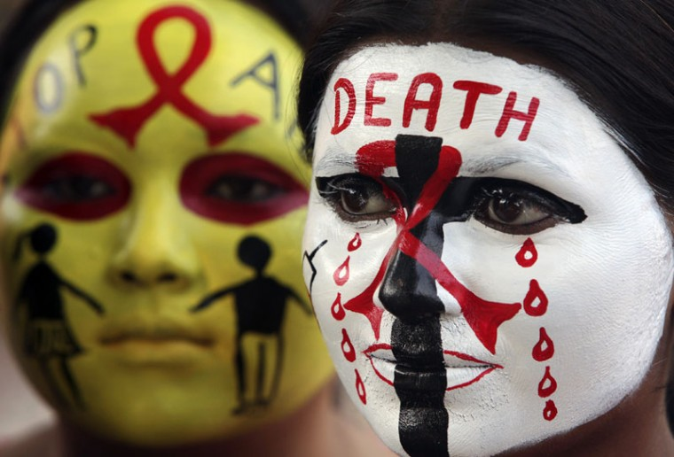Volunteers of National Service Scheme (NSS) pose with HIV/AIDS awareness messages on their faces during a face painting competition ahead of the World AIDS Day in the northern Indian city of Chandigarh November 29, 2014. World AIDS Day is observed on December 1 every year. (Ajay Verma/Reuters)