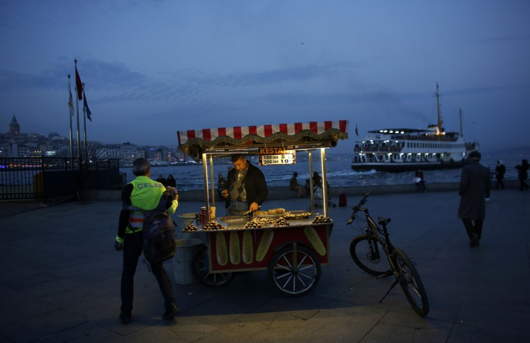 A street vendor sells roasted chestnuts at Eminonu pier in Istanbul December 16, 2014. (REUTERS/Murad Sezer)