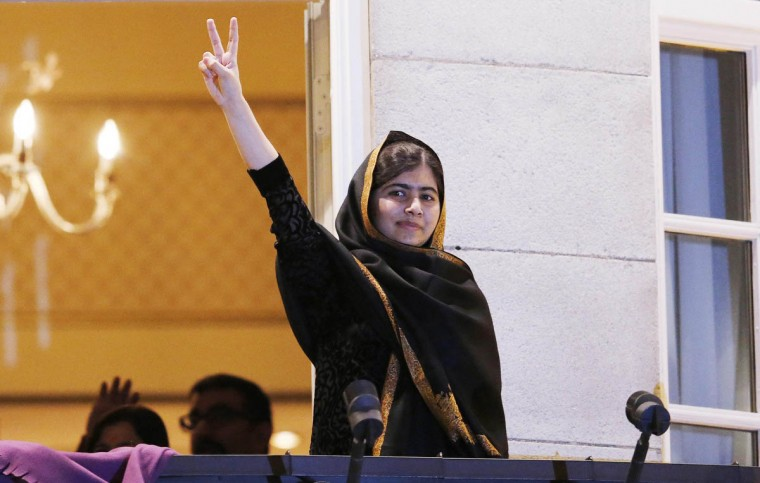 Nobel Peace Prize laureate Malala Yousafzai flashes the 'V' sign from the balcony of the Grand Hotel in Oslo. Pakistani teenager Yousafzai, shot by the Taliban for refusing to quit school, and Indian activist Kailash Satyarthi received their Nobel Peace Prizes on Wednesday after two days of celebration honouring their work for children's rights. (Suzanne Plunkett/Reuters photo)
