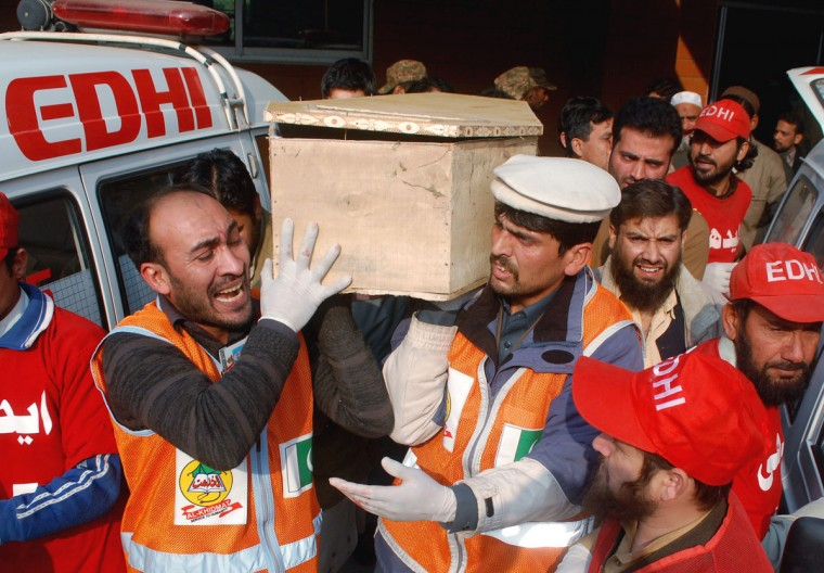 Rescue workers and family members carry the coffin of a student, who killed during an attack by Taliban gunmen on the Army Public School, in Peshawar, December 16, 2014. Taliban gunmen in Pakistan took hundreds of students and teachers hostage on Tuesday in a school in the northwestern city of Peshawar, military officials said. (REUTERS/Khuram Parvez)