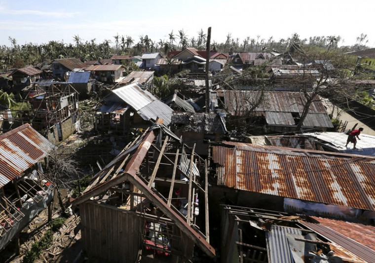 """A general view of damaged houses swept by Typhoon Hagupit in Eastern Samar, in central Philippines December 8, 2014. Typhoon Hagupit weakened to a tropical storm as it churned close to the Philippine capital on Monday, after killing 27 people on the eastern island of Samar island where it flattened homes, toppled trees and cut power and communications. Manila shut down as Hagupit, which means """"lash"""" in Filipino, took aim at the tip of the main island Luzon, just south of the capital city of 12 million people. (Stringer/Reuters)"""