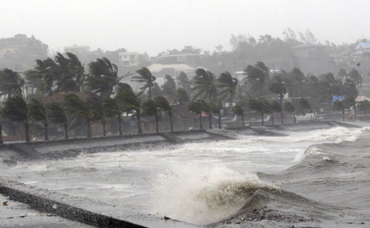 Strong winds and waves brought by Typhoon Hagupit pound the seawall in Legazpi City, Albay province southern Luzon December 7, 2014. The powerful typhoon tore through the central Philippines on Sunday, bringing howling winds that toppled trees and power and cut off communications in areas where thousands were killed by a massive storm just over a year ago. (Stringer/Reuters)