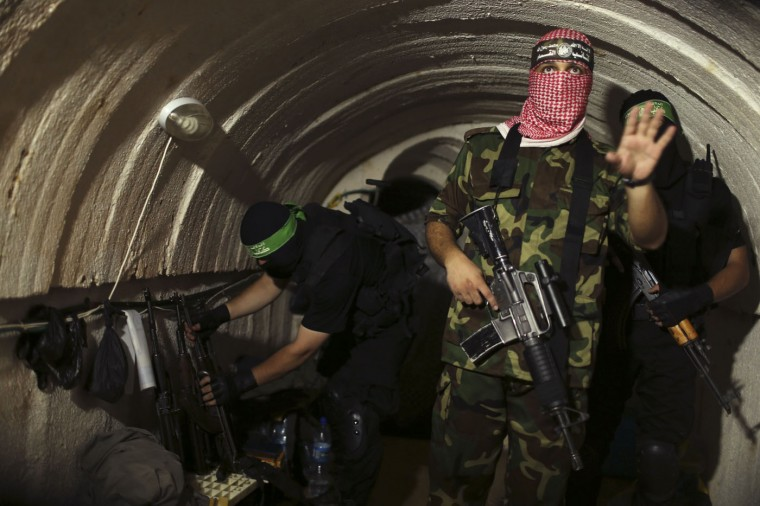 A Palestinian fighter from the Izz el-Deen al-Qassam Brigades, the armed wing of the Hamas movement, gestures inside an underground tunnel in Gaza in this August 18, 2014 file photo. A rare tour that Hamas granted to a Reuters reporter, photographer and cameraman appeared to be an attempt to dispute Israel's claim that it had demolished all of the Islamist group's border infiltration tunnels in the Gaza war. I was part of a Reuters team who were given exclusive access to take pictures of the tunnels used by Hamas' armed wing to fight against Israel. We were blindfolded by Hamas militants and guided to an undisclosed location. Suddenly I found myself inside a dark and scary tunnel. I could barely breathe inside the place it was so deep and cold. The dim light and narrowness of the tunnel made it very difficult to take pictures. It was a very special story as the Reuters team were the first people to be allowed into the tunnels. The pictures were published in many papers and magazines around the world. - Mohammed Salem