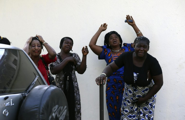 Bystanders react as victims of a bomb blast arrive at the Asokoro General Hospital in Abuja in this April 14, 2014 file photo. A morning rush-hour bomb killed at least 71 people at a Nigerian bus station near the capital. I had just shot the wedding of the president's daughter in Abuja and was looking forward to a quiet week. On my way home I was listening to the radio and then came the announcement of an explosion in the busy Nyanya suburb. My heart flashed with panic and anxiety, and I decided to go to the nearest hospital. Gaining access to the premises was a challenge but after a lot of pleading I managed to persuade security to let me in. The sight was unbearable, and the smell of burnt skin filled the air. The crowd gathered at the hospital was overtaken with emotion and pandemonium ensued. As I was shooting away, there came another siren from the gate. I turned and noticed these women standing by the wall, close to the morgue, breaking down in tears and calling on God to help put an end to senseless killings. I turned my camera towards the women and tried to compose the shot carefully, but from my position the vehicle behind which the women were standing was intruding into the frame. There was no way to quickly relocate and recompose the shot, as I did not want to interfere with what was going on. - Afolabi Sotunde