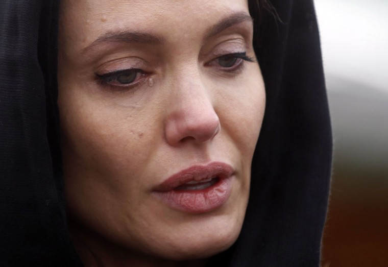 Actress Angelina Jolie cries at the Srebrenica Genocide Memorial in Potocari in this March 28, 2014 file photo. I was covering Angelina Jolie's visit to the Srebrenica Genocide Memorial and Cemetery, commemorating the brutal murder of 8,000 people in 1995, when she started to cry. Afterwards, she was due to visit rape victims' homes in the town of Zenica, so many photographers fled to the entrance to capture her departure. But I stayed on the floor, shooting, and was one of the lucky few to see her tears. Capturing this image was a challenge as there was a lot of travelling involved for very few photographs. The weather was hot, there was a lack of organisation and I was often bothered by colleagues. But this image had a great impact when the whole world wrote about her visit to Bosnia, this photograph was especially powerful because of her tears. Angelina's tears and the photos I took meant a lot to me. I was happy because the whole world will hear about what happened in Srebrenica. But I was also sad, because of the reason for her arrival and because Srebrenica was mentioned solely in the context of war. - Dado Ruvic