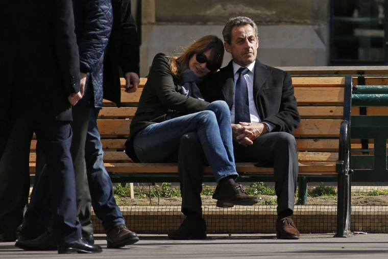 Former French President Nicolas Sarkozy sits on a bench with his wife Carla Bruni-Sarkozy in Paris, in this March 23, 2014 file photo. I was covering the first round of the French municipal elections in Paris and went to a local poll station in a school where Nicolas Sarkozy and Carla Bruni-Sarkozy were due to cast their votes. Afterwards they exited through the courtyard to avoid the crowds outside and realising the door was shut, sat together on a bench while waiting for the concierge to fetch the key. I had stayed behind in a school corridor to send out the photos I had just taken when I spotted the open door. I got inside the courtyard where there were two other photographers. Nicolas Sarkozy and Carla saw us, so I got only around 15 seconds to take their picture before their security staff stood in front of them. - Benoit Tessier