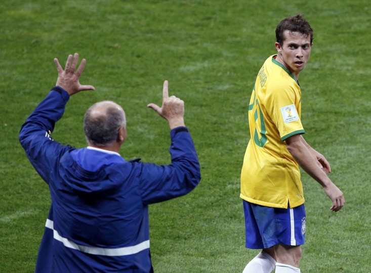 Brazil's coach Luiz Felipe Scolari (L) gestures to Bernard during their 2014 World Cup semi-finals against Germany at the Mineirao stadium in Belo Horizonte in this July 8, 2014 file photo. After Germany had scored an amazing six goals to none from Brazil, I thought I should start keeping an eye on Brazil's coach Luiz Felipe Scolari as he would certainly receive some harsh criticism after the game for his team's dramatic loss. He is always very animated during a game, and this moment occurred as he was yelling to a player to come off the field. The number he was yelling ended up being extremely symbolic, as Germany went on to defeat Brazil by 7 goals. I had a split-second to capture this moment. - David Gray