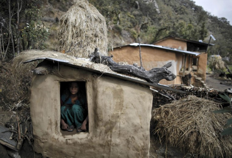 Uttara Saud, 14, sits inside a Chaupadi shed in the hills of Legudsen village in Achham District in western Nepal in this February 16, 2014 file picture. Chaupadi is the practice of treating women as impure and untouchable when they menstruate. In isolated regions like Achham, chaupadi has been a custom for centuries. But those from Nepal's cities or from abroad often don't know what it means. When women go through their monthly cycle, they are not allowed to enter a house or pass by a temple. They cannot use public water sources, touch livestock, attend social events like weddings, or touch others. And at night, they are not allowed to sleep in their homes - instead they have to stay in sheds or outbuildings, often with no proper windows or doors. As I worked on this story, I met many women who had been affected by the tradition. Uttara Saud, a shy 14-year-old girl, told me that she has to miss school during her monthly cycle. I realized that chaupadi does not just bring discomfort and isolation to the women practicing it - sometimes they even have to pay with their lives. Isolated and poorly protected from the elements, they can be killed by snake bites, freezing weather, wild animal attacks, or fires they light to keep warm, which can cause blazes or suffocation in small sheds with poor ventilation. There have also been cases of these women, cut off from their families, being the victims of rape. - Navesh Chitrakar