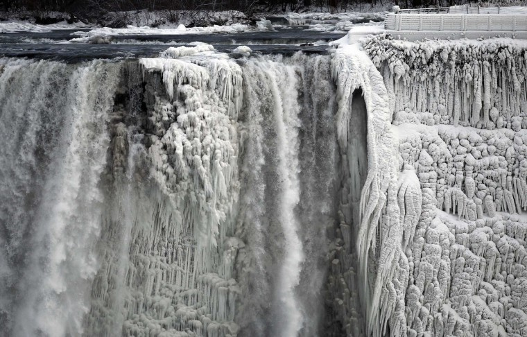 The U.S. side of the Niagara Falls is pictured in Ontario, in this January 8, 2014 file picture. I was out on a specific assignment to photograph the partially frozen Niagara Falls. There was a lot of angry muttering under my frozen breath that day, mostly asking myself why I lived there in winter, laced with several expletives. I wasn't outside for very long, but taking photographs in such a bitter-cold temperatures was challenging. I was dressed appropriately for the weather, but the bone-cracking cold still pierced through all the layers. I had only brought two cameras and two lenses knowing there was no way I'd be changing anything out there. For such a static landscape image I thought it was strong, and from what I've seen and heard, it was widely published. I didn't think the image would strike the chord it did, as I've never photographed a weather feature generating so much of a reaction. I think it was a testament to how strongly people felt about the miserable winter we had to endure. - Aaron Harris