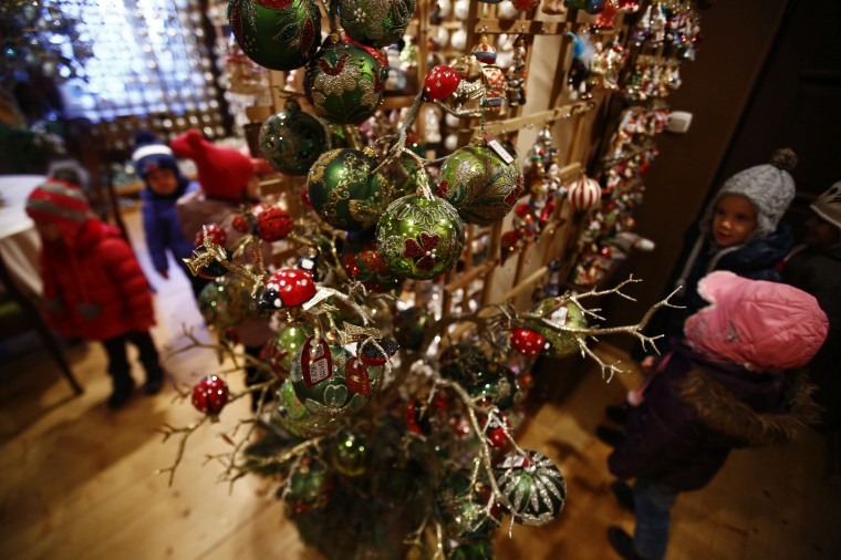 Children from Warsaw kindergarten visit the Silverado manufacture of hand-blown Christmas ornaments in the town of Jozefow outside Warsaw December 2, 2014. REUTERS/Kacper Pempel