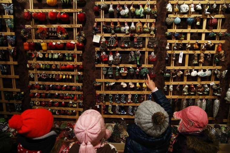 Children from Warsaw kindergarten point glass decorations as they visit the Silverado manufacture of hand-blown Christmas ornaments in the town of Jozefow outside Warsaw December 2, 2014. REUTERS/Kacper Pempel