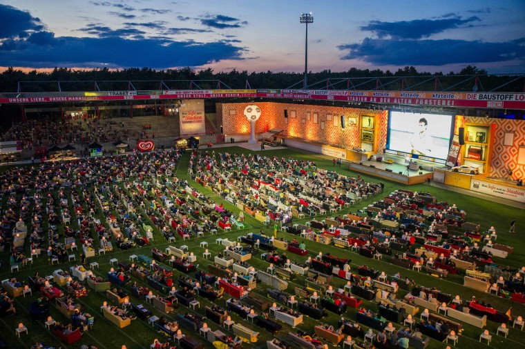 People sit on sofas as they watch the opening game of the 2014 World Cup between Brazil and Croatia, during a public viewing event at the Alte Foersterei stadium in Berlin, in this June 12, 2014 file photo. REUTERS/Thomas Peter/Files