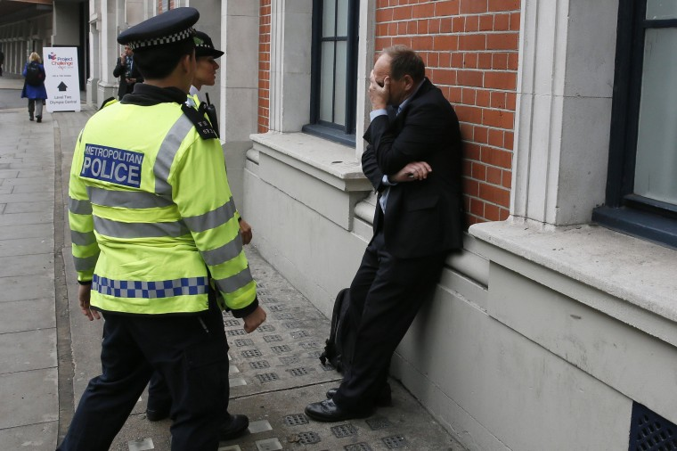 A visitor to the MIPIM property fair reacts as he is detained by police officers following scuffles with housing campaigners outside Olympia exhibition and conference centre in London, in this October 15, 2014 file photo. REUTERS/Stefan Wermuth