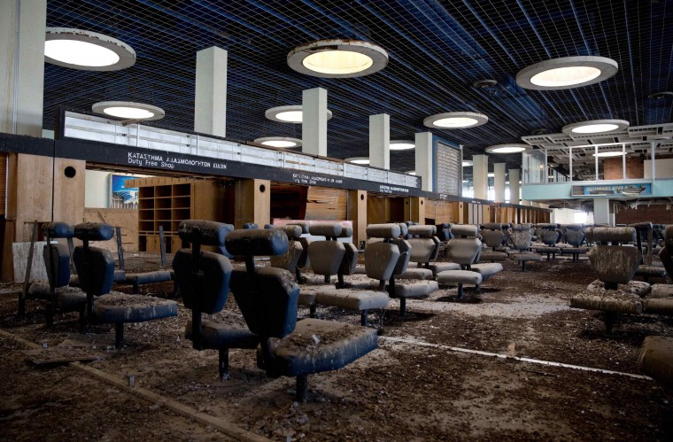The passenger departure area is seen at the abandoned Nicosia International Airport near Nicosia, in this March 10, 2014 file photo. REUTERS/Neil Hall