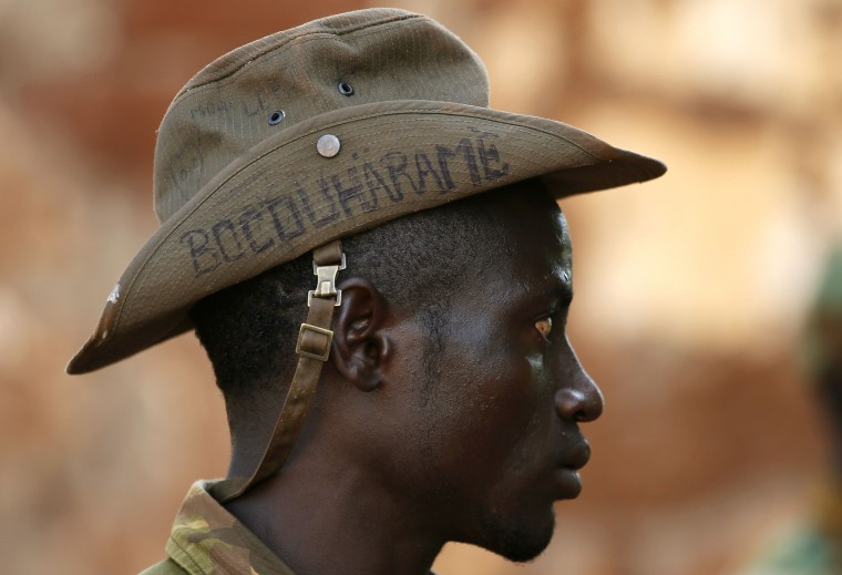 """A Seleka fighter wears a hat that reads """"Bocou Harame"""", in a reference to the Islamist militant group Boko Haram, in the town of Bria, in this April 9, 2014 file photo. REUTERS/Goran Tomasevic"""