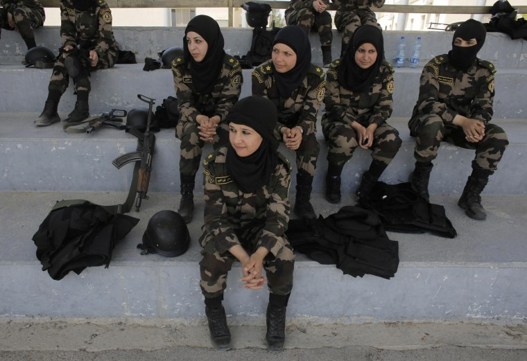 Female members of the Palestinian presidential guard watch a training session in the West Bank city of Jericho, in this April 6, 2014 file photo. REUTERS/Ammar Awad
