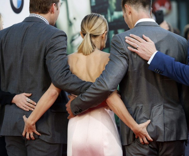 """Cast members Ryan Hansen, Kristen Bell, and Jason Dohring (L-R) pose at the premiere of """"Veronica Mars"""" in Hollywood, California in this March 12, 2014 file photo. REUTERS/Mario Anzuoni"""